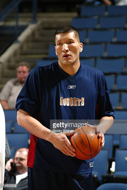 Mengke Bateer of the Denver Nuggets warms up before the game against the Golden State Warriors at The Arena in Oakland California DIGITAL IMAGE NOTE...
