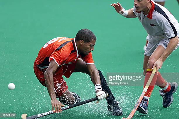 Michael Green of Germany is tackled by Xavier Arnau of Spain during the World Cup Hockey match between Germany and Spain held at the Bukit Jalil...