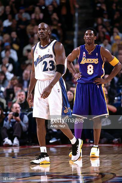 Michael Jordan of the Washington Wizards and Kobe Bryant of the Lakers takes a break in the action during the 2002 NBA All Star Game at the First...
