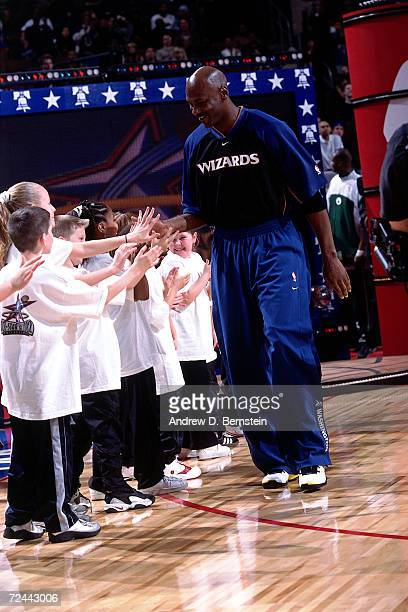 Michael Jordan of the Washington Wizards greets some young fans during player intros before the 2002 NBA All Star Game at the First Union Center in...