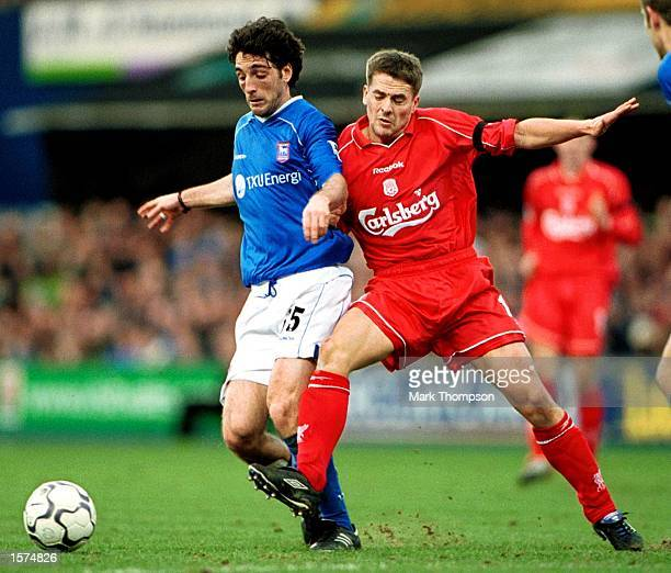 Michael Owen of Liverpool battles for the ball with Sixto Peralta of Ipswich during the FA Barclaycard Premiership match between Ipswich Town and...