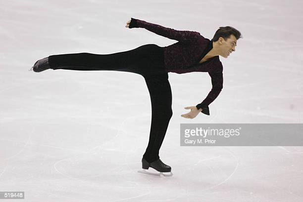 Michael Weiss of the USA competes in the men's free program during the Salt Lake City Winter Olympic Games at the Salt Lake Ice Center in Salt Lake...