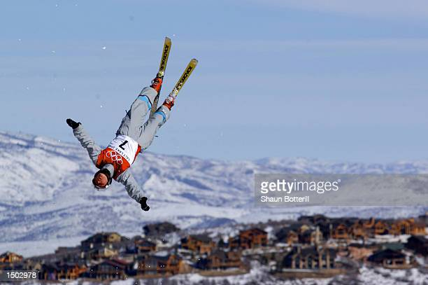Natalia Orekhova of Russia lofts above the horizon as she competes in the qualifying round of the women's aerials during the Salt Lake City Winter...