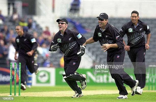 Nevin the Wicketkeeper Stephen Fleming and Tuffey of New Zealand celebrate the run out of Graham Thorpe of England during the New Zealand v England...
