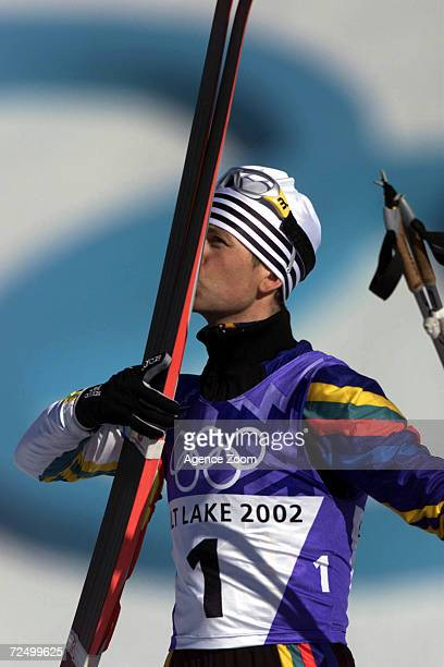 Ole Einar Bjorndalen of Norway celebrates after winning gold in the men's 125km biathlon pursuit during the Salt Lake City Winter Olympic Games at...