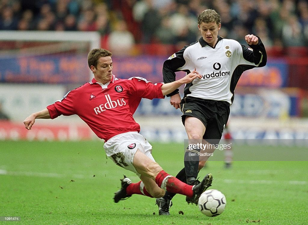 Ole Gunnar Solskjaer of Manchester United takes the ball past Scott Parker of Charlton Athletic during the FA Barclaycard Premiership match played at The Valley, in London. Manchester United won the match 2-0. \ Mandatory Credit: Ben Radford/Allsport