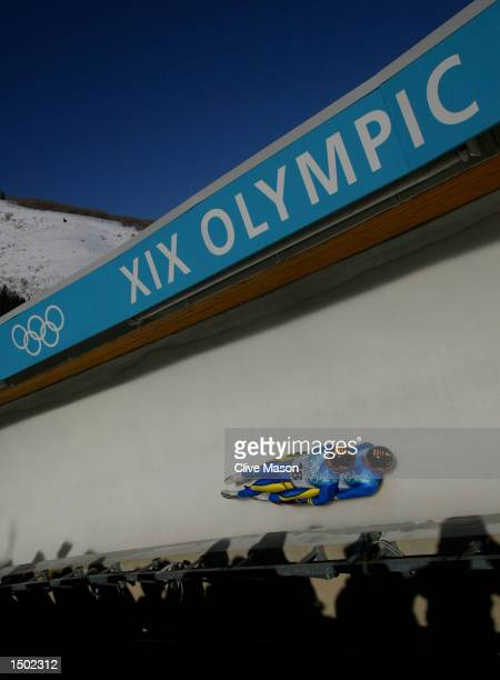 Oleg Avdeev and Danylo Panschenko of Russia compete in the men's doubles luge event during the Salt Lake City Winter Olympic Games at the Utah...