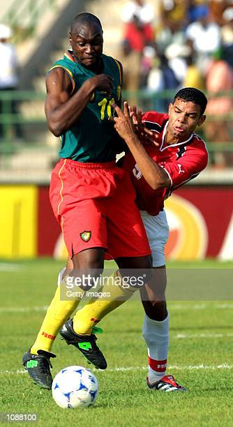 Patrick Mboma of Cameroon and El Zaher El Saka of Egypt in action during the quarter final of the African Cup of Nations match between Cameroon and...