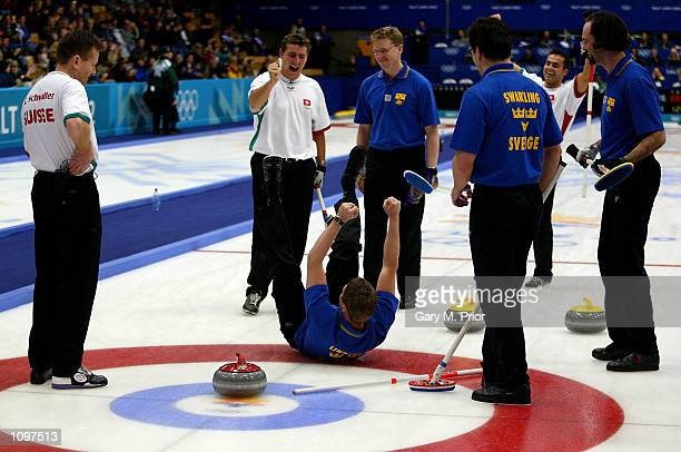 Peja Lindholm of Sweden punches the air in joy as he places the curling stone in the centre spot as a joke Switzerland then went onto win the men's...