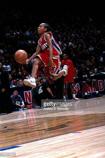 Performer Lil Bow Wow drives to the basket for a scoop shot during the 2002 NBA com Slam Dunk presented by Realone during the NBA All Star Weekend at...