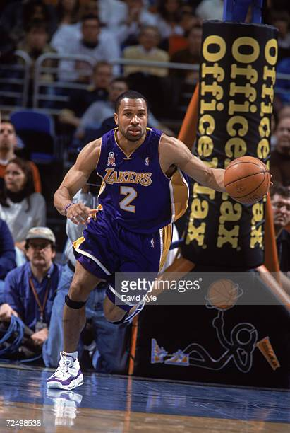 Point guard Derek Fisher of the Los Angeles Lakers dribbles the ball during the NBA game against the Cleveland Cavaliers at the Gund Arena in...