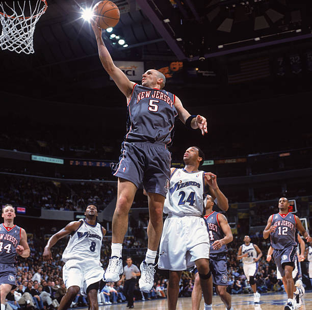 21 Feb 2002  Point guard Jason Kidd  5 of the New Jersey Nets shoots the  ball as guard Hubert Davis  24 of the Washington Wizards stands under the  basket ... bc1ac5671