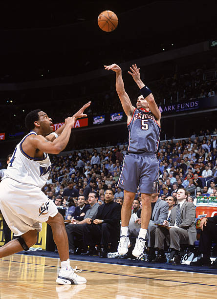 21 Feb 2002  Point guard Jason Kidd  5 of the New Jersey Nets shoots the  ball over forward  44 of the Washington Wizards during the NBA game at the  MCI ... b6097e13a