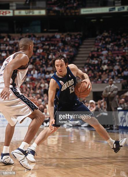 Point guard Steve Nash of the Dallas Mavericks catches the ball during the NBA game against the New Jersey Nets at the Continental Airlines Arena in...