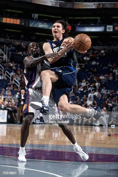 Point guard Steve Nash of the Dallas Mavericks goes for the hoop as Tony Delk of the Phoenix Suns plays defense during the NBA game at the America...