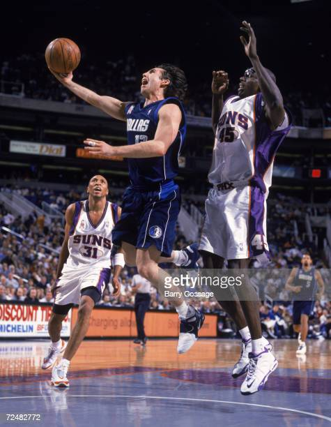 Point guard Steve Nash of the Dallas Mavericks goes for the basket during the NBA game against the Phoenix Suns at the America West Arena in Phoenix...