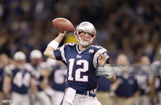 Quarterback Tom Brady of the New England Patriots throws a pass during the game against the StLouis Rams at Superbowl XXXVI at the Superdome in New...