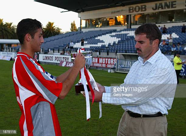 Ramazan Tausancioglu captain of the Melbourne Knights accepts the trophy from Ange Postecogolou after winning the National Youth League Southern...