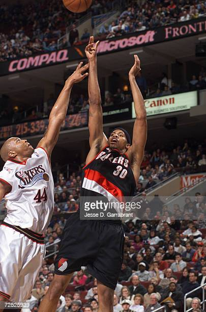 Rasheed Wallace of the Portland Trail Blazers shoots over Derrick Coleman of the Philadelphia 76ers during their game at First Union Center in...