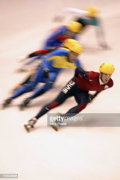 Rusty Smith of the USA leads the way in the Men's 1500m Short Track Speed Skating heats during the Salt Lake City Winter Olympic Games at the Salt...