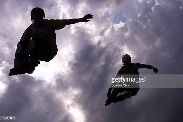 Sam Forgaty and Toby Heslop of Australia in action during the Men's double Vert Finals at the 2002 Asian XGames and Junior XGames Qualifier held at...