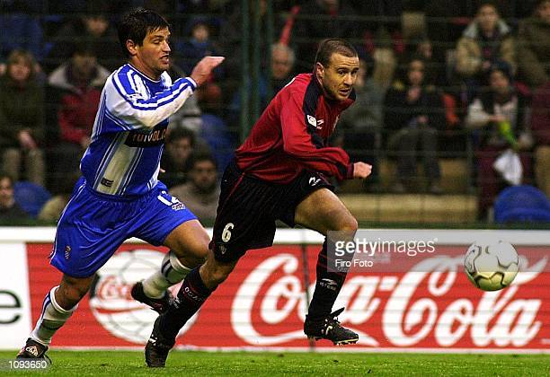 Sanchez Alfredo of Osasuna and Antonio Pacheco of Espanyol in action during the Primera Liga match between Osasuna and Espanyol played at El Sadar...