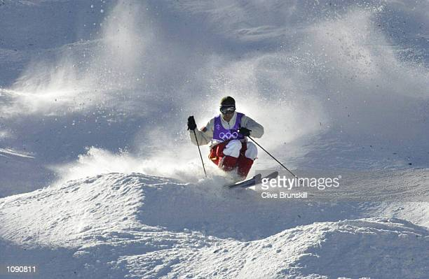 Scott Belavance of Canada competes in the final round of the men's moguls during the Salt Lake City Winter Olympic Games at the Deer Valley Resort in...