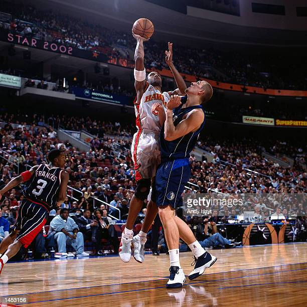 Shareef AbdurRahim of the Atlanta Hawks shoots against Dirk Nowitzki of the Dallas Mavericks during the 2002 NBA All Star Game at the First Union...