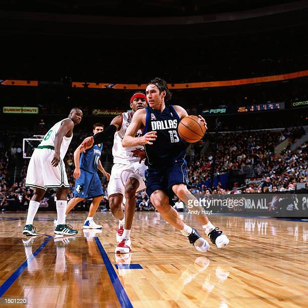 Steve Nash of the Dallas Mavericks drives to the basket against Allen Iverson of the Philadelphia 76ers during the 2002 NBA All Star Game at the...