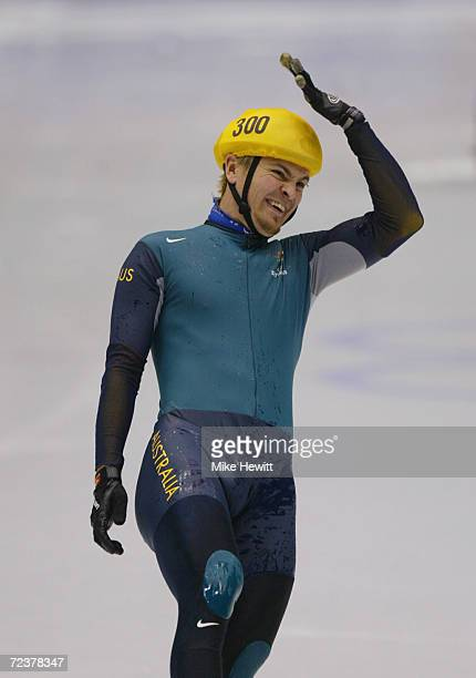 Steven Bradbury of Australia gestures after crossing the finish line to win the gold medal in the men's 1000m speed skating final at the Salt Lake...