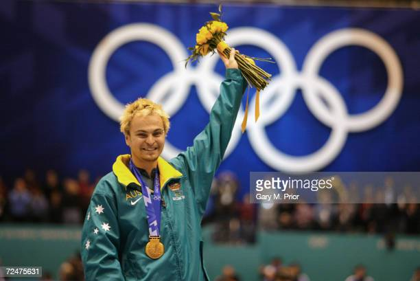 Steven Bradbury of the Australia receives the gold medal in the men's 1000m speed skating during the Salt Lake City Winter Olympic Games at the Salt...