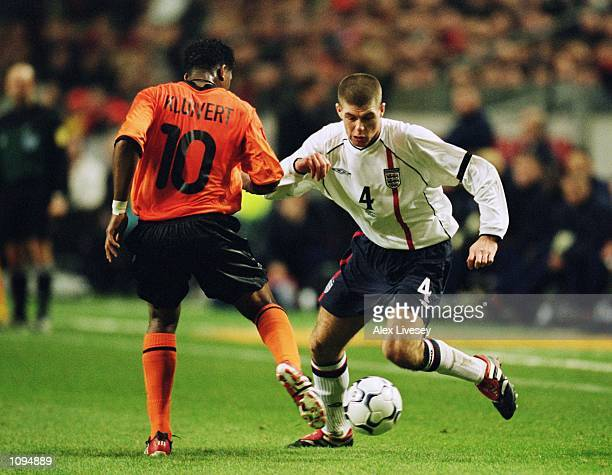 Steven Gerrard of England looks to take the ball past Patrick Kluivert of Holland during the International Friendly match played at the Amsterdam...