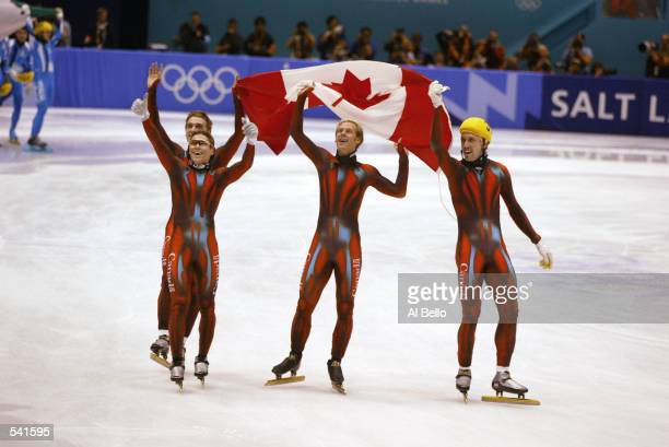 Team Canada celebrates their win in the men's 5000m speed skating relay final during the Salt Lake City Winter Olympic Games at the Salt Lake Ice...