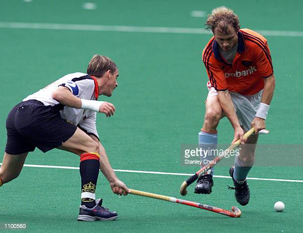 Teun de Nooijer of Netherlands is checked by Xavier Arnau of Spain during the World Cup Hockey match between Netherlands and Spain held at the Bukit...