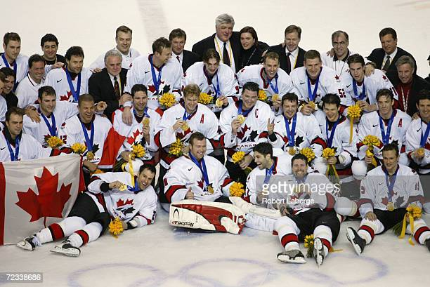 The Canada team pose for a group photo after winning the mens ice hockey gold medal game 5-2 over team USA during the Salt Lake City Winter Olympic...