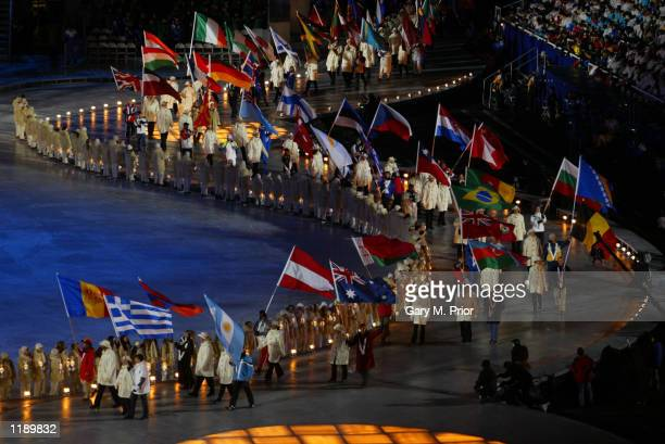 The flags enter the stadium during the Closing Ceremony of the Salt Lake City Winter Olympic Games at the RiceEccles Olympic Stadium in Salt Lake...