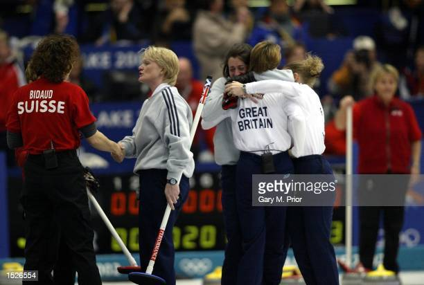 The GBR team celebrate after winning the gold medal in the Great Britain v Switzerland women's curling gold medal match during the Salt Lake City...