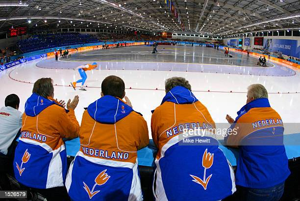 The Netherlands coaches watch Jachem Uytdehaage set a new World Record of 125892 in the men's 10000m speed skating event during the Salt Lake City...