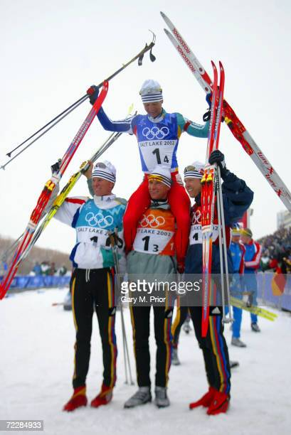 The Norwegian team celebrate their gold medal in the men's 4 x 75km biathlon relay during the Salt Lake City Winter Olympic Games at Soldier's Hollow...