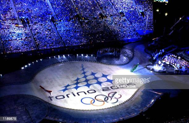 The official logo for the next host city Torino 2006 is projected onto the ground during the Closing Ceremony of the Salt Lake City Winter Olympic...