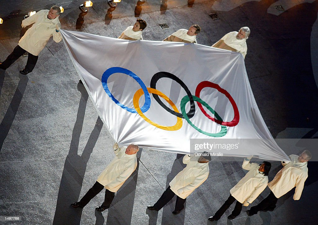 The Olympic Flag is carried into the stadium during the Opening Ceremony of the 2002 Salt Lake City Winter Olympic Games at the Rice-Eccles Olympic Stadium in Salt Lake City, Utah. DIGITAL IMAGE. Mandatory Credit: DONALD MIRALLE/Getty Images