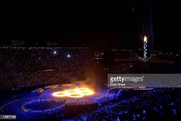 The Olympic rings burn on the ice in the center of the stadium during the Opening Ceremony of the Salt Lake City Winter Olympic Games at the Rice...