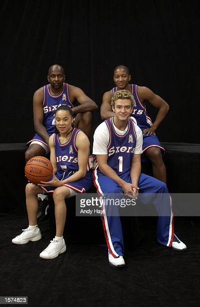 The Philadelphia 76ers represented by Moses Malone Eric Snow Dawn Staley and Justin Timberlake pose for a portrait before the 989 Sports HoopItUp...