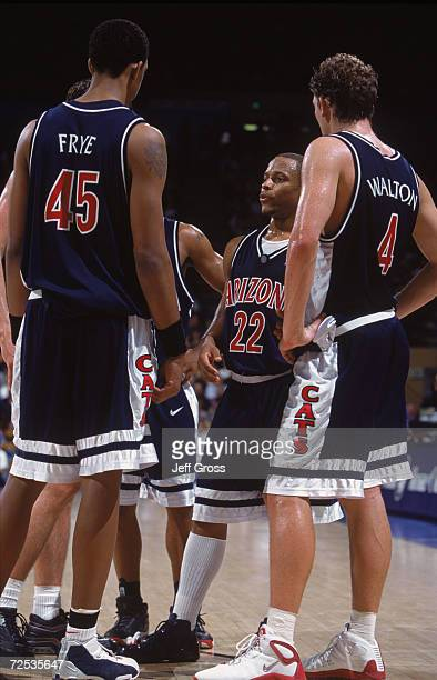 Three Arizona Wildcats guard Jason Gardner forward Luke Walton and center Channing Frye talk to each other during the NCAA game against the UCLA...