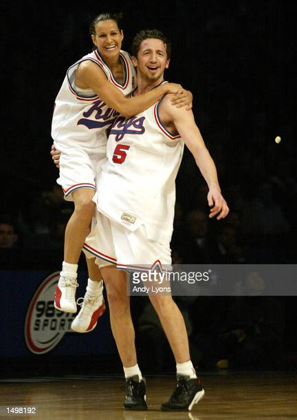 Tich Penicheiro of the Sacramento Monarchs and Hedo Turkoglo of the Sacramento Kings celebrate after winning the 989 Sports AllStar Hoop ItUp game...