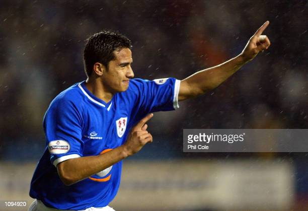 Tim Cahill of Millwall celebrates scoring the first goal during the Nationwide Division One match between Millwall and West Bromwich Albion at the...