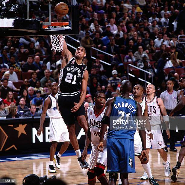 Tim Duncan of the San Antonio Spurs drives to the basket for a dunk against Kevin Garnett of the Minnesota Timberwolves during the 2002 NBA All Star...