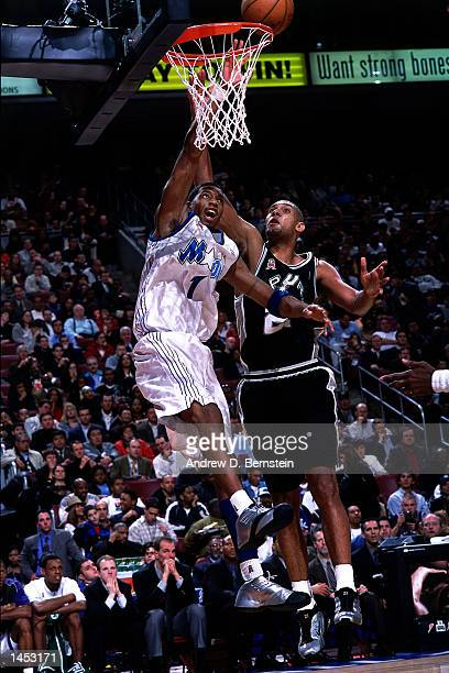 Tim Duncan of the San Antonio Spurs goes for a block on Tracy McGrady of the Orlando Magic during the 2002 NBA All Star Game at the First Union...