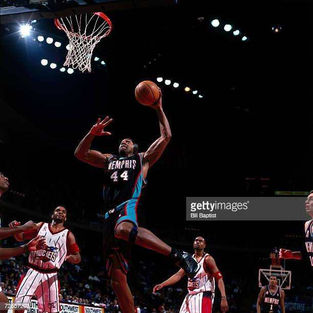 Tony Massenburg of the Memphis Grizzlies goes for a dunk against the Houston Rockets during the NBA game at The Compaq Center in Houston TexasNOTE TO...