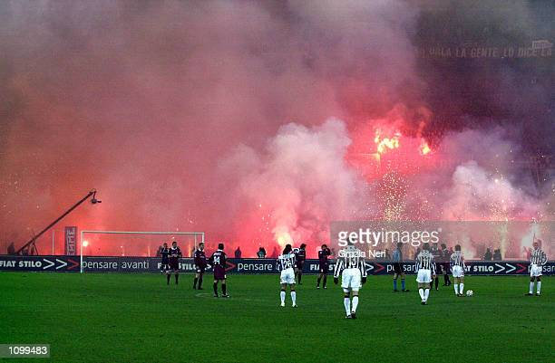 Torino fans let off flares during the Serie A match between Torino and Juventus played at the Delle Alpi Stadium Turin DIGITAL IMAGE Mandatory Credit...